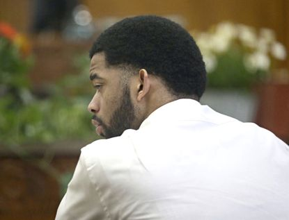 Dominique Heaggan-Brown listens to the statement he made to investigators after the shooting is read back to him in court by Special Agent Raymond Gibbs of the Wisconsin Department of Justice on June 16, 2017, in Milwaukee.