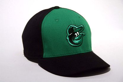 Orioles reveal green hats to be worn in Sunday's games