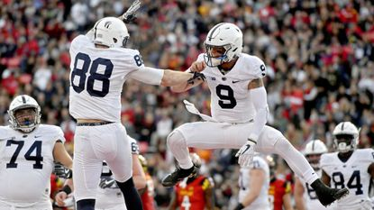 Penn State tight end Mike Gesicki (88) and quarterback Trace McSorley celebrate a touchdown against Maryland at Maryland Stadium in College Park on Saturday, Nov. 25, 2017. The visiting Nittany Lions won, 66-3.