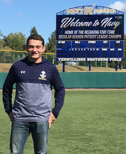 Catonsville resident and 2020 Gilman graduate Jackson Tacka poses on the Naval Academy field where he will play college baseball.