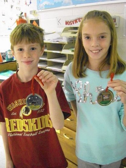 In their fourth-grade art class, 35 Eldersburg Elementary students created ornaments for the Maryland State House Holiday Tree. Here, Ben DeShong, left, and Rachael Sutton display the ornaments they made.