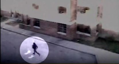 Surveillance footage shows a man running through West Baltimore's Gilmor Homes complex on the morning of April 12, when Freddie Gray sustained a fatal spine injury while in police custody.