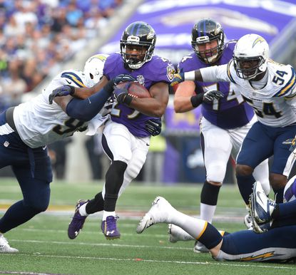 Ravens' #29 Justin Forsett on a fourth quarter run as he gets away from Chargers' #91 Kendall Reyes.