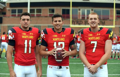 Left to right, Terps quarterbacks Perry Hills, Daxx Garman and Caleb Rowe at University of Maryland football media day at Capital One Field at Byrd Stadium.