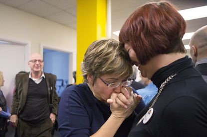Wanda Morris, center, former CEO of Dying with Dignity Canada, embraces colleague Anya Colangelo at the group's offices in Toronto in 2015 after Canada's highest court unanimously struck down a ban on doctor-assisted suicide for mentally competent patients with terminal illnesses.