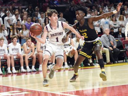 Broadneck's Brendan Davis, seen on the left looking to make a pass in a game against Richard Montgomery last season, led the Bruins to a 63-52 win against Southern on Friday, Jan. 17.