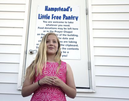 Makenzie Greenwood, 10, speaks during a dedication ceremony for Hampstead's Little Free Pantry, which was created with help from Venturing Crew 2013 at St. John's United Methodist Church in Hampstead Tuesday, May 16, 2017.