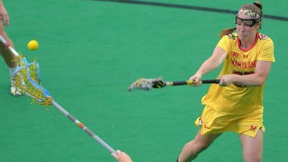 Maryland attacker Megan Whittle fires against Johns Hopkins Blue Jays defender Lily Schmitt (17) during the 2017 Big Ten women's lacrosse semifinals.