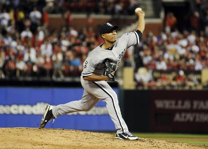 Jose Quintana of the White Sox pitches against the Cardinals Tuesday night in St. Louis.