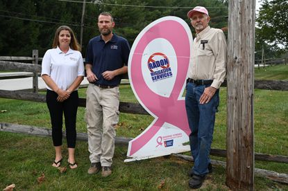 Mike Dietz, right, owner of Radon Mitigation Services by G.M.D. Construction, Inc., joined by his daughter Wendy Rimbey and son John Dietz on Thursday, October 3. Dietz and his company are a sponsor of the upcoming Making Strides Walk in Mount Airy.