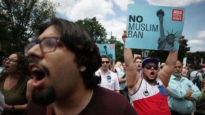 WASHINGTON, DC - JUNE 26: People demonstrate against U.S. President Trump's travel ban as protesters gather outside the U.S. Supreme Court following a court issued immigration ruling June 26, 2018 in Washington, DC. The court issued a 5-4 ruling upholding U.S. President Donald Trump's travel ban imposing limits on travel from several primarily Muslim nations. (Photo by Mark Wilson/Getty Images) ** OUTS - ELSENT, FPG, CM - OUTS * NM, PH, VA if sourced by CT, LA or MoD **