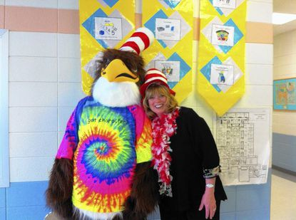 "Mascot Freddie the Falcon and Fulton Elementary School Principal Karen Moore-Roby sport ""Cat in the Hat"" toppers as they celebrate national Read Across America week."