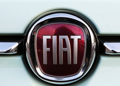 "A Fiat logo pictured on a car in Bayonne, southwestern France, Thursday, Oct.31, 2019.The boards of Fiat Chrysler and PSA Peugeot announced Thursday fast-moving plans to merge the two companies creating the world's fourth-largest automaker with enough scale to confront ""the new era in mobility""."