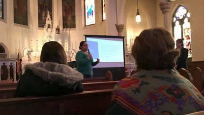 Giuliana Valencia-Banks, a legal administrative assistant at Catholic Charities of Baltimore's Esperanza Center, explains immigrants' rights at a seminar Sunday at St. Patrick's Church in Fells Point. Photo by Scott Dance, Baltimore Sun