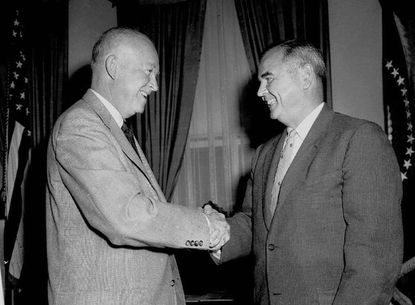 FILE--President Eisenhower, left, shakes the hand of Judge William J. Brennan Jr. in his White House office on Sept. 29, 1956, after selecting Brennan to be an associate justice of the U.S. Supreme Court.