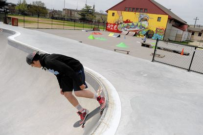 Keith Martin of Hampden drops down into the new bowl at the Skatepark of Baltimore at Roosevelt Park in Hampden on Friday, April 25.