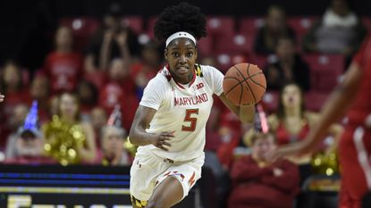 Maryland's Kaila Charles drives the ball against Rutgers in the second half of a NCAA basketball game, Monday, Dec. 31, 2018.
