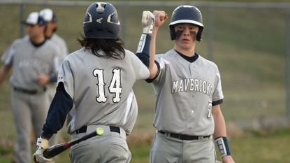 Manchester Valley's Dalton Groupp (14) celebrates scoring a run with teammate Brett DeWees during a baseball game at Francis Scott Key High School on Thursday, March 28.