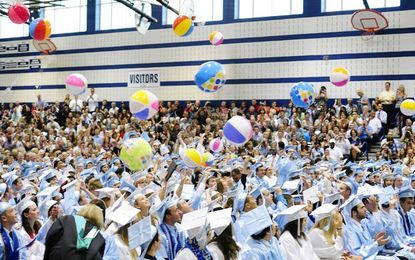 Cheers ring out and beach balls fly as the C. Milton Wright Class of 2012 celebrates during Wednesday evening's ceremony at Bel Air High School.