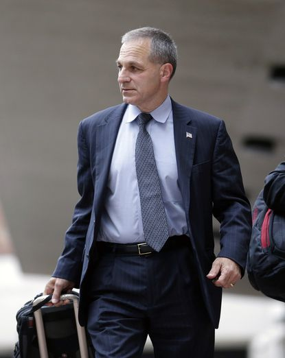In this July 2, 2013, file photo, former FBI Director Louis Freeh leaves Federal Court in New Orleans.