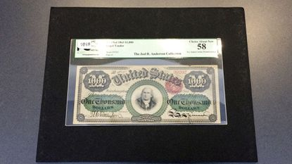 A $1,000 bill printed in 1863 is seen on display in Baltimore. The rare bill, which features Declaration of Independence signer Robert Morris, is expected to sell for around $1 million when it goes up for auction in Baltimore Thursday.