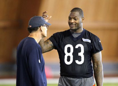Chicago Bears tight end Martellus Bennett talks to coach Marc Trestman during the team's minicamp in June.
