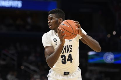 Georgetown center Qudus Wahab (34) handles the ball during the second half of an NCAA college basketball game against Butler, Tuesday, Jan. 28, 2020, in Washington. Butler won 69-64. (AP Photo/Nick Wass)