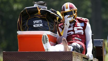 Washington Redskins linebacker Reuben Foster rides a cart off the field after suffering an injury during a practice at the team's NFL football practice facility, Monday, May 20, 2019, in Ashburn, Va.