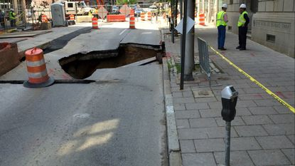 A sinkhole opened up in the 100 block of W. Centre St. in Baltimore as utility work was being done in the area.
