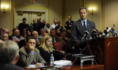 Maryland Gov. Martin O'Malley responds to a senator's question during a hearing on gun control before the Senate Judicial Proceedings Committee.