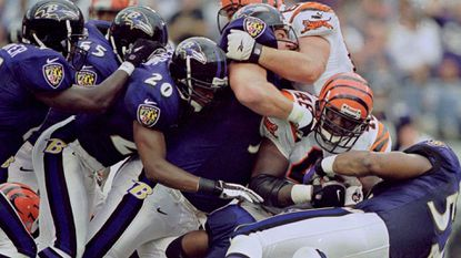 Bengals fullback Cliff Groce (46) is stopped short of a first down on third-and-1 in the third quarter Sept. 24, 2000, at PSINet Stadium. The Ravens held Cincinnati to 4 rushing yards.