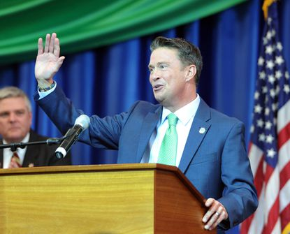 Barry Glassman waves to the crowd as he takes the podium for some remarks after being sworn in as Harford County's new County Executive.