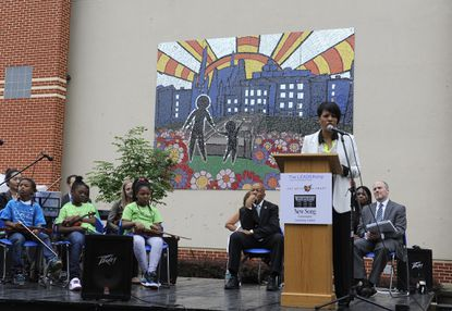Mayor Stephanie Rawlings Blake speaks at the unveiling ceremony for a new mosaic at New Song Academy in Sandtown-Winchester.The mosaic project, coordinated by nonprofit Art with a Heart and the Greater Baltimore Committee's LEADERship program, aimedto bring hope to the community after the unrest.