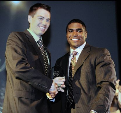 Baltimore County teacher of the year award is presented to Sean McComb from Patapsco High by Superintendent Dallas Dance.