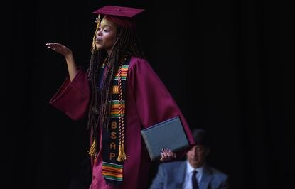Nia Bronson blows a kiss from the stage after accepting her diploma during the graduation ceremony for Hammond High School's Class of 2021 at Merriweather Post Pavilion on Friday, June 4, 2021.