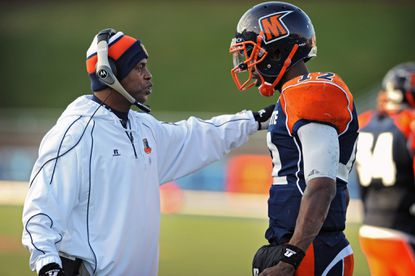 Morgan State football coach Lee Hull, left, talks with quarterback Moses Skillon, right, during his team's game-winning drive in the fourth quarter against South Carolina State, Nov. 15, 2014.