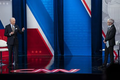 Anderson Cooper listens as President Joe Biden answers questions during a televised town hall event at the Pabst Theater in Milwaukee on Tuesday.
