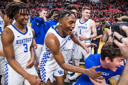 Kentucky's Immanuel Quickley, middle, and the rest of the Wildcats leave the court after a 76-74 win against Texas Tech at United Supermarkets Arena in Lubbock, Texas on Jan. 25, 2020.