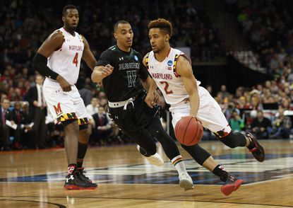 Maryland's Melo Trimble, right, and Robert Carter Jr. were named to the National Basketball Coaches Association All-District 7 team.