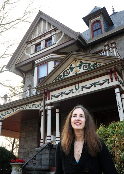 """Carol Nemeth stands in front of her dream home, a """"Victorian Lady"""" that she now operates as a bed-and-breakfast."""