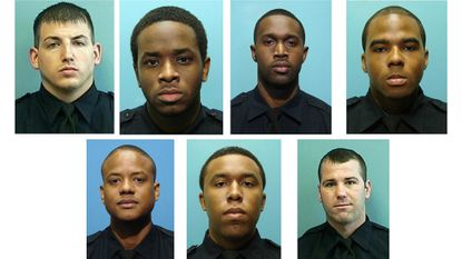The seven officers indicted on racketeering charges; Det. Daniel Hersl is bottom right