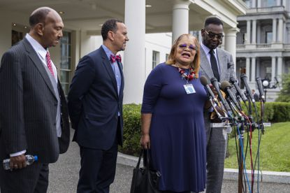 Alveda King, second from right, niece of civil rights leader Martin Luther King Jr., together with other religious leaders, from left, the Rev. Bill Owens, the Rev. Dean Nelson and Bishop Harry Jackson, speaks to reporters following a meeting with President Donald Trump at the White House in Washington, Monday, July 29, 2019. (AP Photo/Manuel Balce Ceneta)