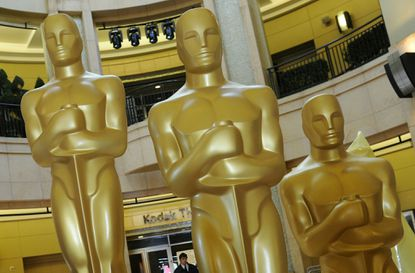 Giant Oscars stand in the foyer of what used to be called the Kodak Theatre, site of the 84th annual Academy Awards.