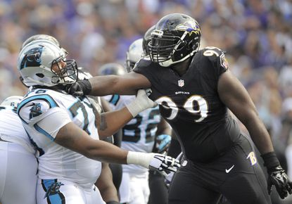 Chris Canty exchanges a few words Carolina Panthers lineman Nate Chandler during a game last season.
