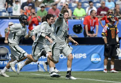Loyola lacrosse players, including Greg Catalano, center, rush the field after defeating Maryland 9-3 in the Division I NCAA men's lacrosse championship game at Gillette Stadium in Foxborough, Mass., Monday, May 28, 2012.