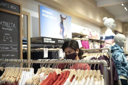 Customer Jojo Manalansan shops for clothing at Athleta Tuesday, June 1, 2021, in Chicago.