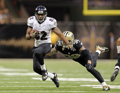 Ravens wide receiver Torrey Smith tries to elude the tackle of New Orleans Saints strong safety Kenny Vaccaro in the fourth quarter.