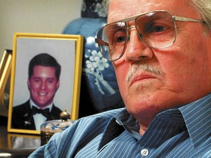 In April 1999, George Williams talked about his son, Geordie (background), who was one of the 270 victims of Pan Am Flight 103 that was destroyed by a bomb that exploded during its flight over Lockerbie, Scotland, in 1988. Williams, who died in November 2012, was determined to confront two Lybian suspects who were released by their country, where they were extradited to the Netherlands for trial.