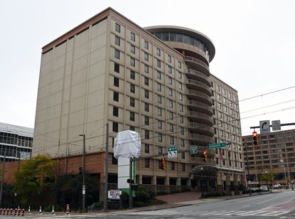 The Holiday Inn Express Baltimore-Downtown was recently closed, a victim of the coronavirus pandemic. The hotel's sign is covered with a white sheet. October 30, 2020.