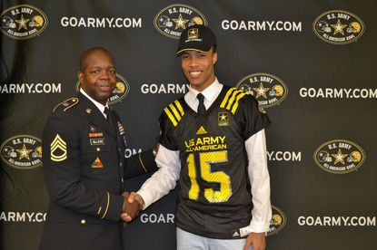 Calvert Hall's Lawrence Cager receives his U.S. Army All-American Bowl jersey.